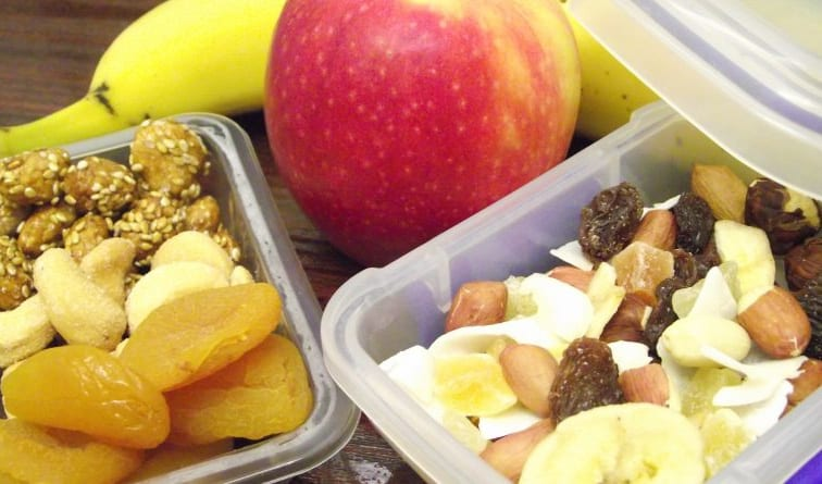plastic containers packed with healthy snacks